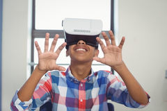 Schoolboy using virtual reality headset in classroom. At school Royalty Free Stock Photography