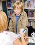 Schoolboy Waiting At Checkout Counter Royalty Free Stock Photography