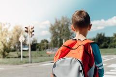 Schoolboy waiting at zebra crossing Stock Photos