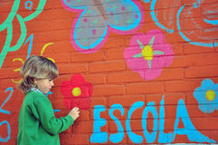 Schoolboy at the wall. Schoolboy painting at the wall Stock Photography