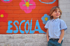Schoolboy at the wall Royalty Free Stock Images