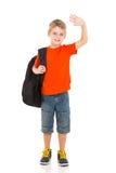 Schoolboy waving goodbye. Smiling schoolboy with backpack waving goodbye Royalty Free Stock Image