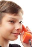 Schoolboy whith phones. Stock Photos