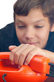 Schoolboy whith phones. Royalty Free Stock Image