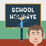 Schoolboy wipes a school board. With the inscription - school holidays, and his friend emotionally looks at what is happening Stock Photography