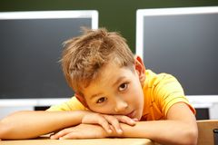 Schoolboy at workplace Royalty Free Stock Photos
