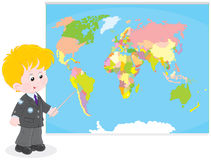 Schoolboy at a World map. School student points to a country on a map of World Royalty Free Stock Photography