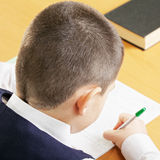 Schoolboy writing above view Royalty Free Stock Photography