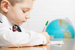Schoolboy writing closeup Royalty Free Stock Images