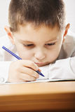 Schoolboy writing closeup Royalty Free Stock Photography