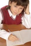 Schoolboy writing formula Royalty Free Stock Image