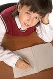 Schoolboy writing formula Stock Photography