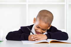 Schoolboy writing homework Stock Images
