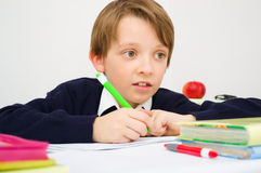 Schoolboy writing homework Stock Photography