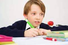 Schoolboy writing homework Stock Photography