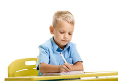 Schoolboy writing on lesson Stock Photography