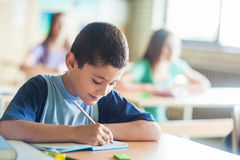 Schoolboy Writing Notes Stock Photos