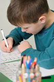 Schoolboy writing Royalty Free Stock Image