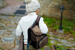 Schoolboy. Youthful lad with satchel wearing knitted sweater and beanie hat Royalty Free Stock Photography