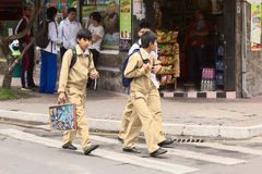 Schoolboys in Banos, Ecuador. BANOS, ECUADOR - FEBRUARY 25, 2014: Unidentified schoolboys in uniforms on the street on February 25, 2014 in Banos, Ecuador Stock Photos