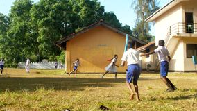 Schoolboys in blue shorts and white shirts play cricket. Colombo/SRI LANKA - APRIL 05 2019: Schoolboys in blue shorts and white shirts play cricket on schoolyard stock video footage