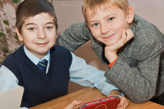 Schoolboys with electronic game Royalty Free Stock Images
