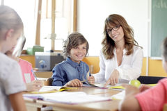 Schoolboys and girls are smiling Stock Photo