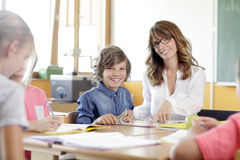 Schoolboys and girls are smiling Stock Images