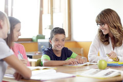 Schoolboys and girls are smiling Royalty Free Stock Photo