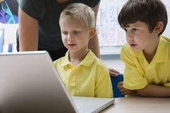 Schoolboys Learning Computer Technology Royalty Free Stock Photo