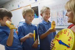Schoolboys Learning To Tell Time Stock Photography