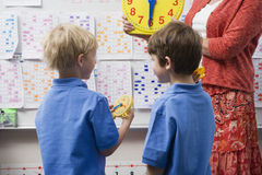 Schoolboys Learning To Tell Time Stock Image