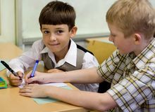 Schoolboys playing. Image about playing schoolboys at a lesson Stock Images