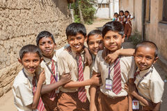 Schoolboys playing in round of friends with smily faces in India Stock Images