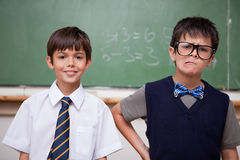 Schoolboys posing in front of a chalkboard Royalty Free Stock Images