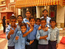 Schoolboys and schoolgirls in India. These Indian children are going to visit Lakshmi-Narayan Temple in New Delhi. They are happy to meet a foreigner who wants Stock Photo