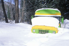 A schoolbus buried in snow Stock Photos