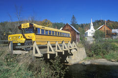 A schoolbus crossing the Waits River Bridge, VT Royalty Free Stock Photo