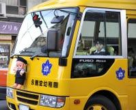 Schoolbus japonés con el niño Fotografía de archivo