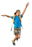 Schoolchild with backpack and a cap jumping Royalty Free Stock Photos