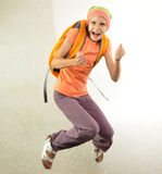 Schoolchild with backpack jumping Royalty Free Stock Photos