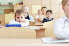 Schoolchild in a class stock photo