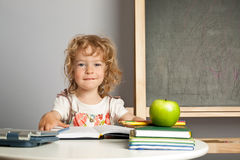 Schoolchild in classroom Stock Images