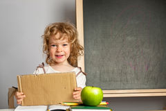 Schoolchild in classroom Royalty Free Stock Image