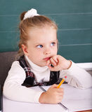 Schoolchild in classroom near blackboard. Royalty Free Stock Image