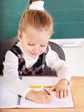 Schoolchild in classroom near blackboard. Stock Photos