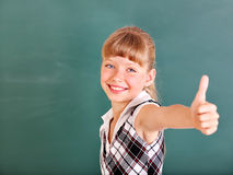 Schoolchild in classroom near blackboard. Royalty Free Stock Photos