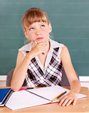 Schoolchild in classroom near blackboard. Stock Photo