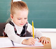 Schoolchild in classroom near blackboard. Royalty Free Stock Photography