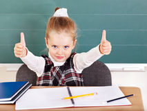Schoolchild in classroom near blackboard. Stock Photography